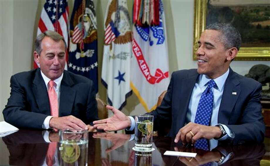 President Barack Obama reaches to shakes hands with House Speaker John Boehner of Ohio, in the Roosevelt Room of the White House in Washington, Friday, Nov. 16, 2012, during a meeting of the bipartisan, bicameral leadership of Congress to discuss the deficit and economy. Photo: Carolyn Kaster, AP / AP