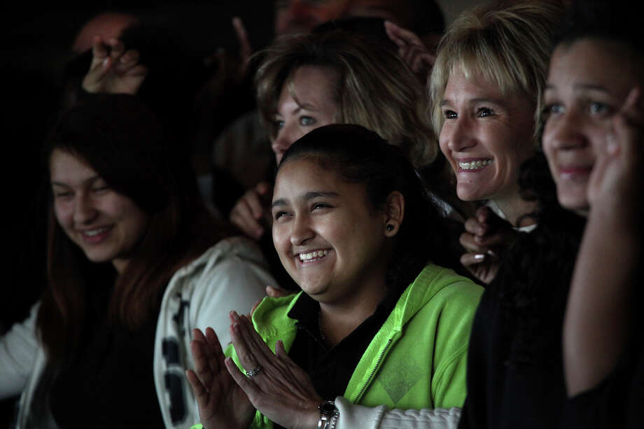 April, 15, and Lori Warren, right, with Spurs Sports & Entertainment, with teens from Big Brothers Big Sisters of South Texas. Photo: Lisa Krantz, San Antonio Express-News / © 2012 San Antonio Express-News