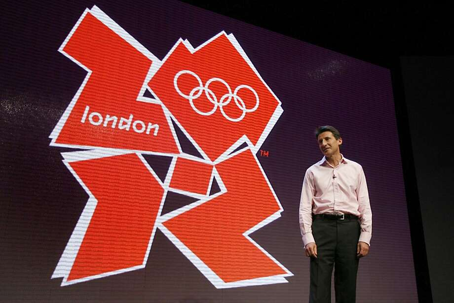 London 2012 Chairman Sebastian Coe stands with the London 2012 Olympic logo, London, Monday June 4, 2007. London Olympic organizers unveiled Monday a neon-colored, jigsaw-style logo for the 2012 Games. The four jagged pieces combine to form the numbers 2012 with the logo in a variety of pink, blue, green and orange colors. Photo: Tom Hevezi, AP