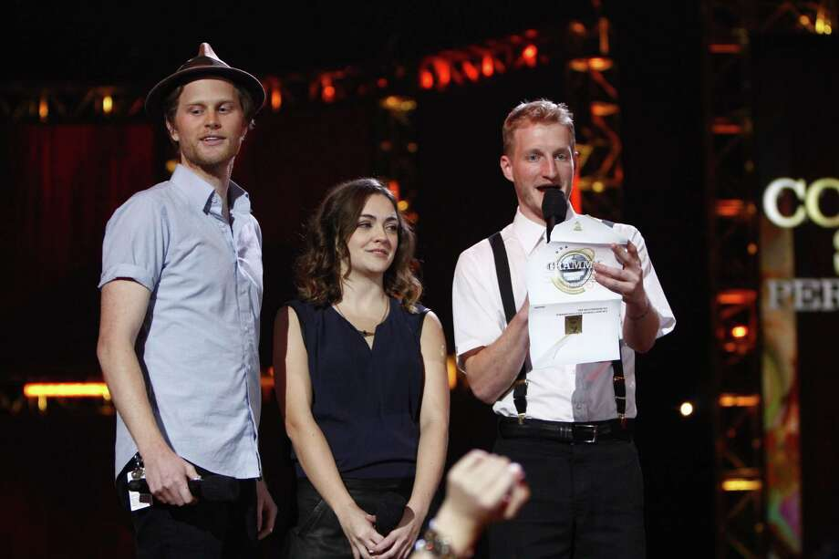 From left, Wesley Schultz, Neyla Pekarek and Jeremiah Fraites, of musical group The Lumineers, announce the nominees for best country solo perfomance at the Grammy Nominations Concert Live! at Bridgestone Arena on Wednesday, Dec. 5, 2012, in Nashville, Tenn. (Photo by Wade Payne/Invision/AP) Photo: Wade Payne / Invision