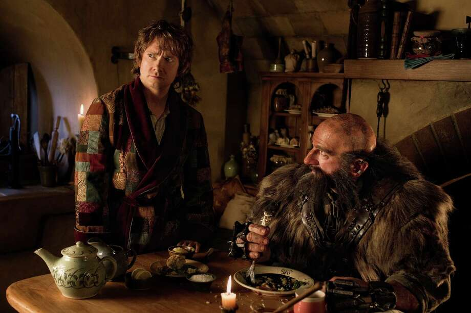 "(L-r) MARTIN FREEMAN as Bilbo Baggins and GRAHAM McTAVISH as Dwalin in the fantasy adventure ""THE HOBBIT: AN UNEXPECTED JOURNEY,"" a production of New Line Cinema and Metro-Goldwyn-Mayer Pictures (MGM), released by Warner Bros. Pictures and MGM. Photo: James Fisher"