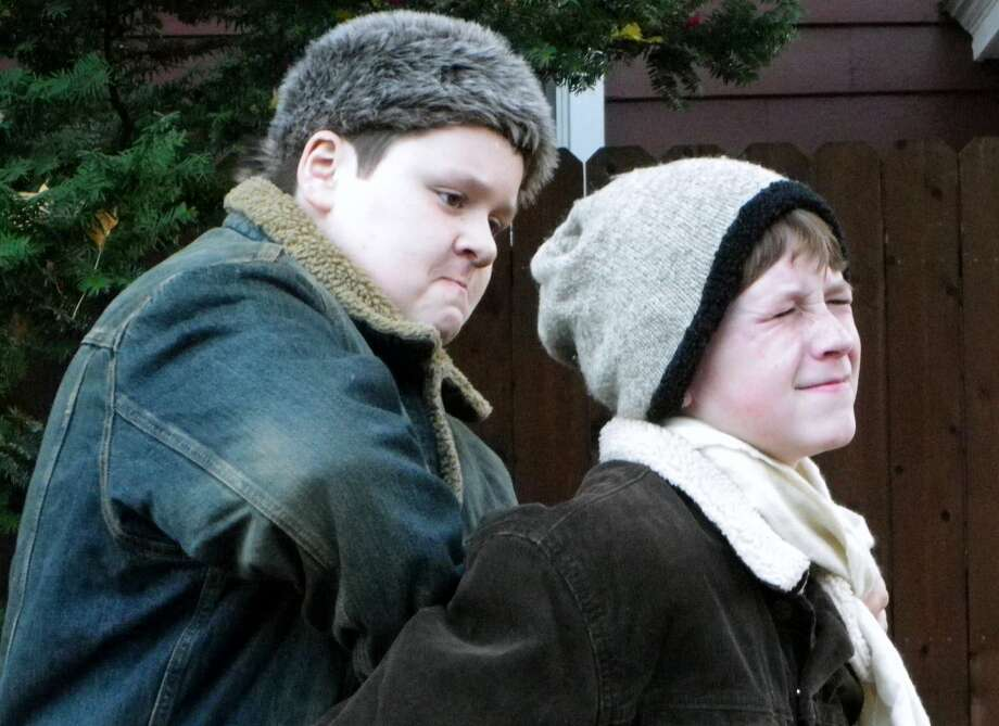 Town bully Scut Farkas (Jake Lehning) has Flick (Casey Roberts) in a bad spot in ''A Christmas Story,'' being staged by the Classic Theatre Guild. (Sheila O'Shea) Photo: Picasa