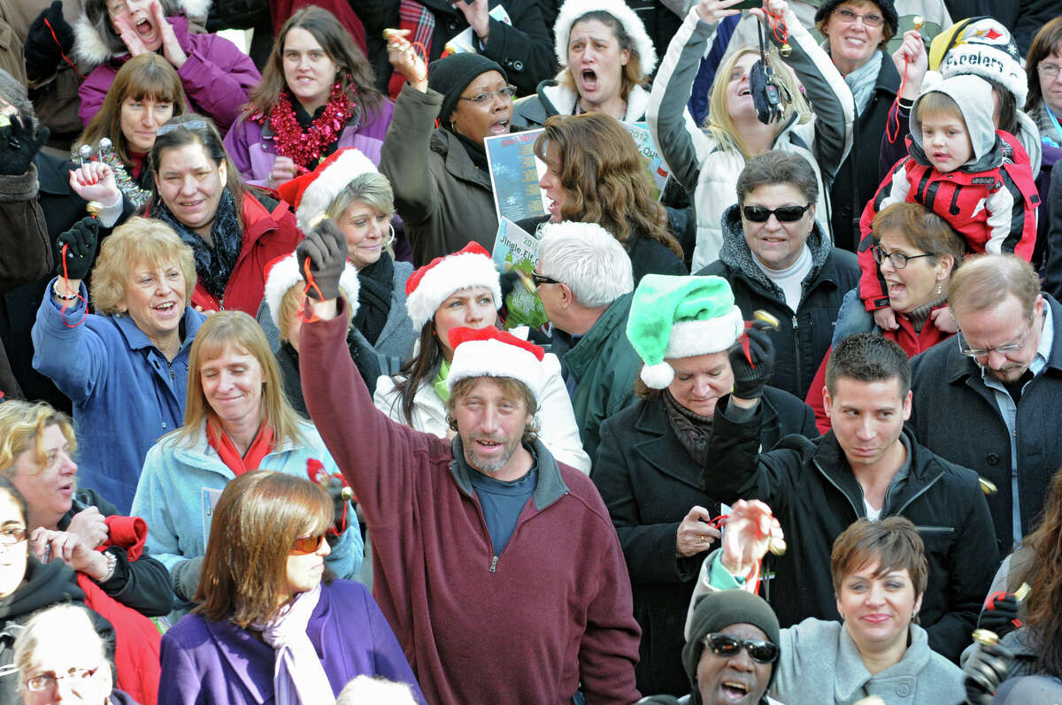 People participate setting the world record for being the largest group singing jingle bells while ringing jingle bells for recordsetter.com in front of the Times Union Center on Wednesday Dec. 12, 2012 at 12 Noon in Albany, N.Y. (Lori Van Buren / Times Union)