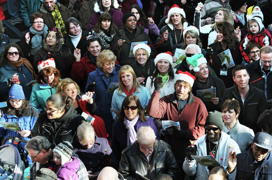 People participate setting the world record for being the largest group singing jingle bells while ringing jingle bells for recordsetter.com in front of the Times Union Center on Wednesday Dec. 12, 2012 at 12 Noon in Albany, N.Y.  (Lori Van Buren / Times Union) Photo: Lori Van Buren