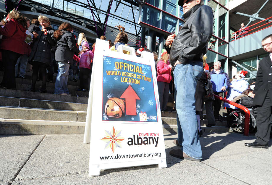 People arrive to participate in setting the world record for being the largest group singing jingle bells while ringing jingle bells for recordsetter.com in front of the Times Union Center on Wednesday Dec. 12, 2012 at 12 Noon in Albany, N.Y.  (Lori Van Buren / Times Union) Photo: Lori Van Buren