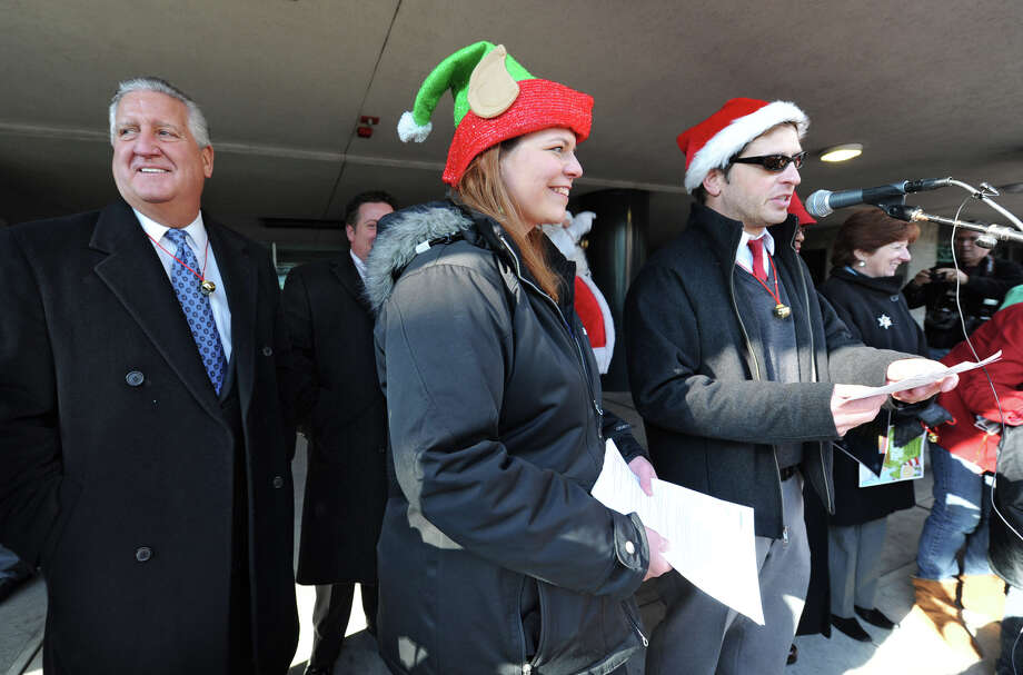 From left, Albany Mayor Jerry Jennings, Marquita Rhodes of the Downtown Albany BID and Chad O'Hara, program director at B95.5 radio station, were speakers and got the crowd going as people participate setting the world record for being the largest group singing jingle bells while ringing jingle bells for recordsetter.com in front of the Times Union Center on Wednesday Dec. 12, 2012 at 12 Noon in Albany, N.Y.  (Lori Van Buren / Times Union) Photo: Lori Van Buren