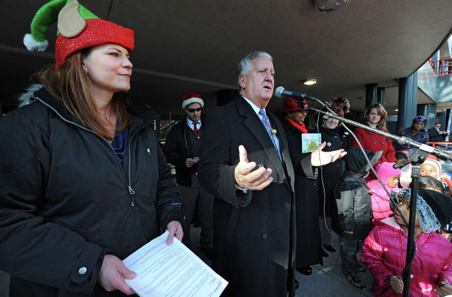 From left, Albany Mayor Jerry Jennings gets the crowd going as people participate setting the world record for being the largest group singing jingle bells while ringing jingle bells for recordsetter.com in front of the Times Union Center on Wednesday Dec. 12, 2012 at 12 Noon in Albany, N.Y. Marquita Rhodes of the Downtown Albany BID, left, listens to the mayor. (Lori Van Buren / Times Union) Photo: Lori Van Buren