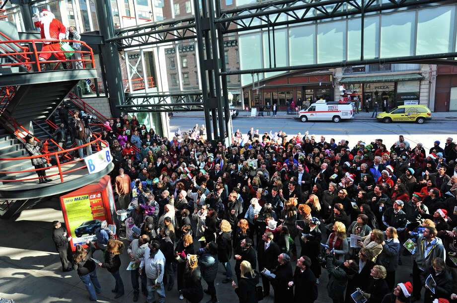 Santa Claus gets a crowd of people going participating in setting the world record for being the largest group singing jingle bells while ringing jingle bells for recordsetter.com in front of the Times Union Center on Wednesday Dec. 12, 2012 at 12 Noon in Albany, N.Y.  (Lori Van Buren / Times Union) Photo: Lori Van Buren