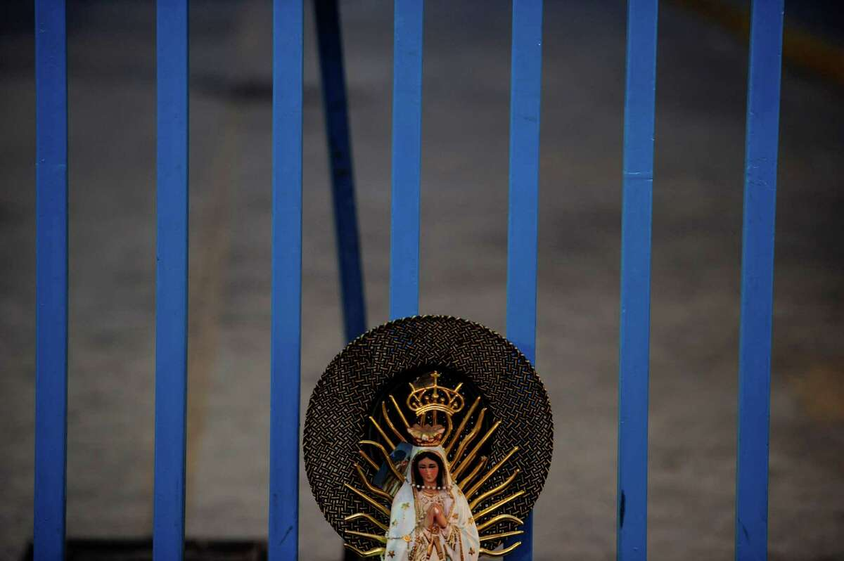View of an image of the Guadalupe Virgin near the Basilica de Guadalupe in Mexico City on December 12, 2012. Mexicans celebrated the appearance of the Virgin of Guadalupe to Juan Diego in 1531. AFP PHOTO/Alfredo EstrellaALFREDO ESTRELLA/AFP/Getty Images