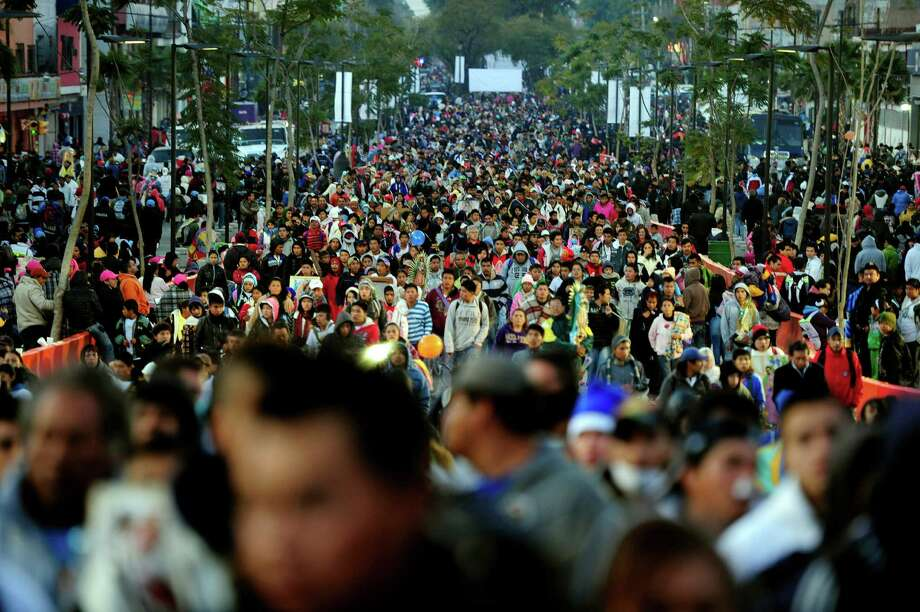 Hundreds of pilgrims arrive to the Basilica de Guadalupe in Mexico City on December 12, 2012. Mexicans celebrated the appearance of the Virgin of Guadalupe to Juan Diego in 1531. AFP PHOTO/Alfredo EstrellaALFREDO ESTRELLA/AFP/Getty Images Photo: ALFREDO ESTRELLA, AFP/Getty Images / AFP