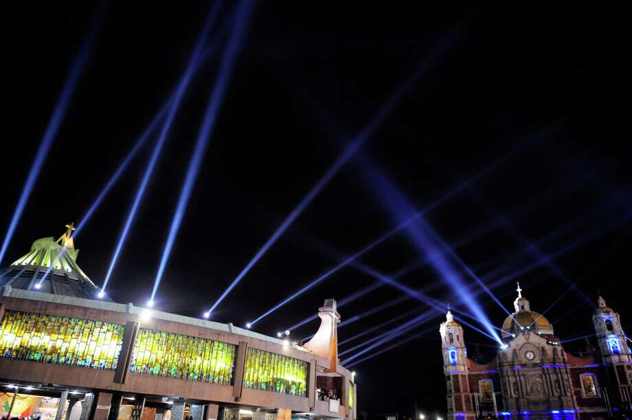Lights are shone in the night sky over the Basilica de Guadalupe in Mexico City on December 11, 2012. Mexicans celebrated the appearance of the Virgin of Guadalupe to Juan Diego in 1531.    AFP PHOTO/Alfredo EstrellaALFREDO ESTRELLA/AFP/Getty Images Photo: ALFREDO ESTRELLA, AFP/Getty Images / ALFREDO ESTRELLA