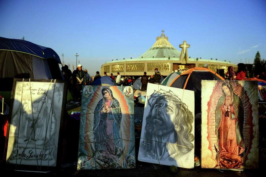 Images of the Guadalupe Virgin and Jesus Christ are displayed near the Basilica de Guadalupe in Mexico City on December 12, 2012. Mexicans celebrated the appearance of the Virgin of Guadalupe to Juan Diego in 1531. AFP PHOTO/Alfredo EstrellaALFREDO ESTRELLA/AFP/Getty Images Photo: ALFREDO ESTRELLA, AFP/Getty Images / AFP