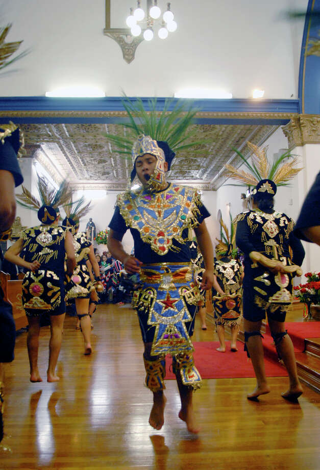 Several groups of local dancers dressed in traditional clothing and most barefoot, take their turns as they enter the Virgin of Guadalupe church in Brownsville, Texas, to honor the Virgin of Guadalupe during a celebration of Virgin of Guadalupe's feast day, Wednesday, Dec. 12, 2012. (AP Photo/The Brownsville Herald, Brad Doherty) Photo: Brad Doherty, Associated Press / BROWNSVILLE HERALD