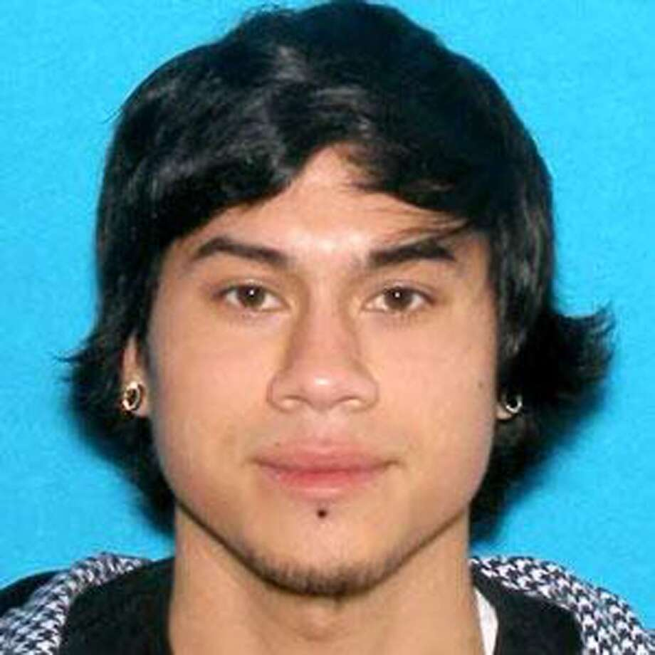 This photo provided by the  Clackamas County Sheriff's Department shows Jacob Tyler Roberts, the  gunman in a shooting at an Oregon Mall on Tuesday.  Roberts, who killed two people and himself in the shooting rampage, was  22 years old and used a stolen rifle from someone he knew, authorities  said Wednesday. Roberts had armed himself with an AR-15 semiautomatic  rifle and had several fully loaded magazines when he arrived at a  Portland mall on Tuesday, said Clackamas County Sheriff Craig Roberts.  (AP Photo/Clackamas County Sheriff's Department)
