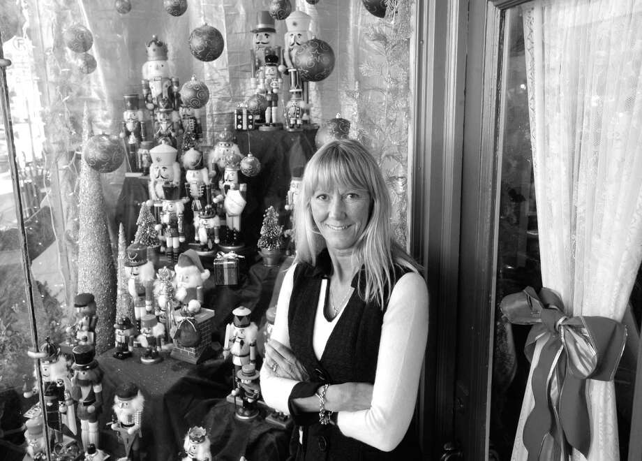Maria Drieghe, manager of The Rummage Room, in front of the store's nutcracker-themed holiday window display last year. Photo: Bob Luckey / Greenwich Time