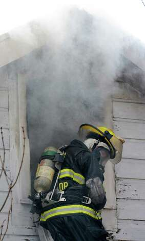Firefighters from numerous Rensselaer County fire companies work to knock down a serious fire at 35 Lakeshore Drive in Schodack, N.Y. Dec 12, 2012.   (Skip Dickstein/Times Union) Photo: Skip Dickstein