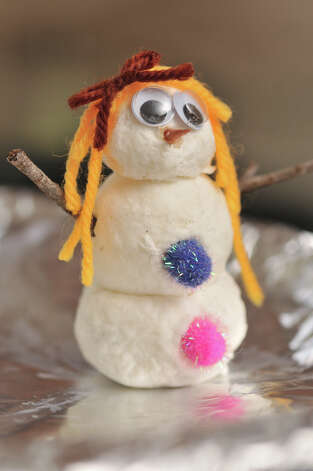 One of the snowmen created by Gavin and Sari Valdez with the help of their mother, Dena Valdez. The main ingredients are shaved bar soap, water, and toilet paper. Photo: Robin Jerstad/For The Express-Ne