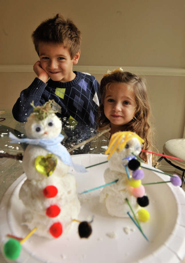 "Gavin and Sari Valdez with their ""snowmen"" created with shaved soap, water, and some toilet paper. Photo: Robin Jerstad/For The Express-Ne"