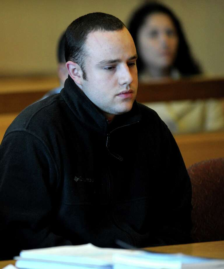 Aaron Ramsey of Wilton is found not guilty by reason of mental disease or deficiency by a three-judge panel during a verdict reading at state Superior Court in Stamford on Wednesday, December 12, 2012. Ramsey was on trial for beating his father, Edward, to death in May after Ramsey allegedly heard voices. Photo: Lindsay Niegelberg, Niegelberg / Stamford Advocate