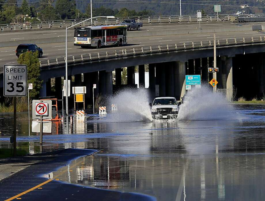 A truck drove through flooding from Bay waters at the highway 1 offramp. Highway 101 is in background. King tides in the Bay Area caused some flooding in Marin County Wednesday December 12, 2012 and many beaches were partially covered. Photo: Brant Ward, The Chronicle