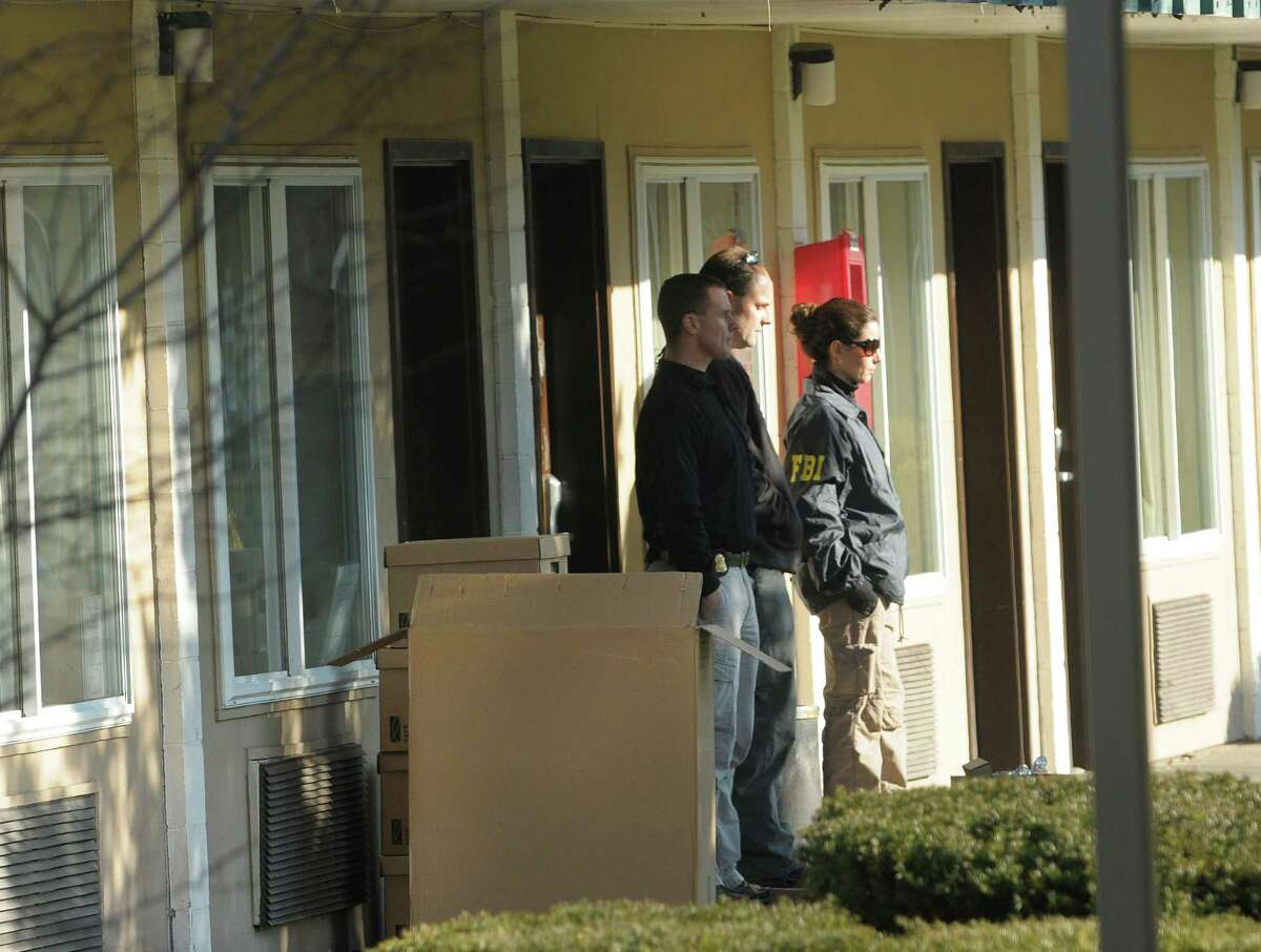Members of the New York State Attorney General's office and the FBI conducted a raid at an office at the Schuyler Inn on Wednesday, Dec. 12, 2012 in Menands, NY. (Paul Buckowski / Times Union)