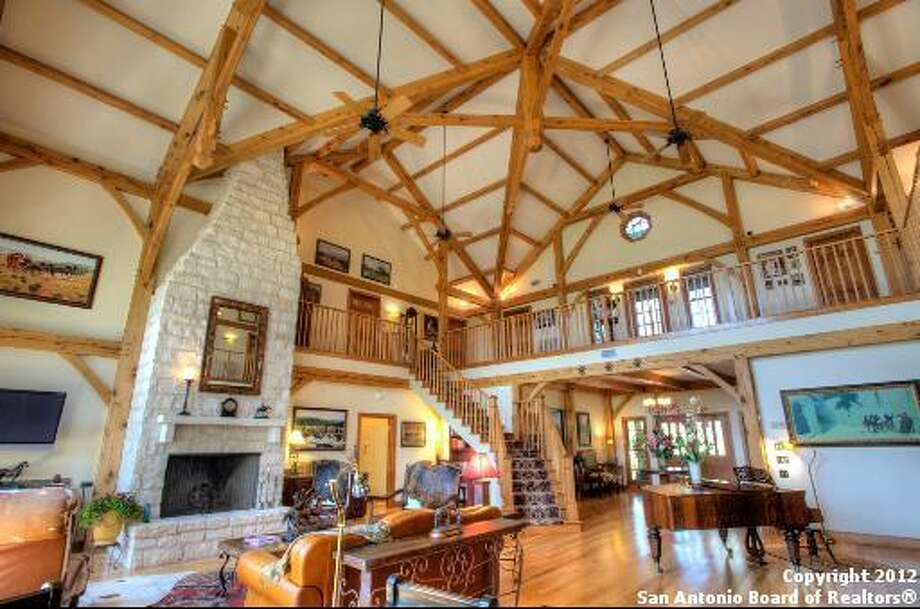 The high cathedral ceilings adds a grandness to the room.