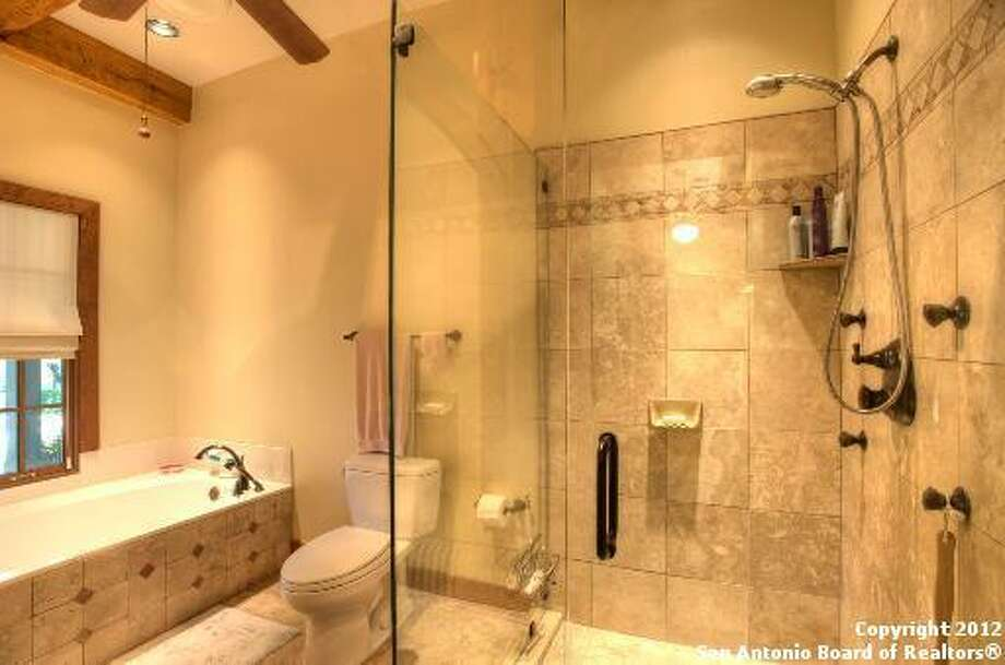 Included in the master bathroom is a large shower stall, soaking tub and tile detailing.