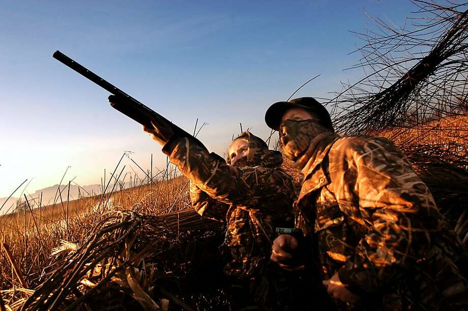** ADVANCE FOR SUNDAY FEB. 27 ** Jessica Worley, 12, left, and her father, Tim Worley, duck hunt during the California Department of Game and Fish-sponsored Junior Hunt Day, Saturday, Feb. 5, 2005, at the Brady Ranch Duck Club near Yuba City, Calif. Hunting has survived through generations by fathers passing it on to their children. Families bonded during hunting trips. Today, many people have given up on hunting, or never tried it at all. (AP Photo/Max Whittaker) Photo: Max Whittaker, AP