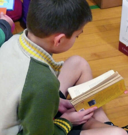 Maxime, a fifth-grader at Holland Hill, is absorbed in a Roald Dahl book. Photo: Genevieve Reilly / Fairfield Citizen
