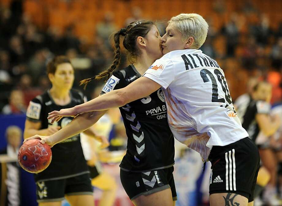 You're just using me for my ball possession:Germany's Anja Althaus (right) appears to sneak a kiss, but Montenegro's Biljana Pavicevic knows the real object of her desire is the handball. (European Women's Handball Championship Group II match in Novi Sad, Serbia.) Photo: Attila Kisbenedek, AFP/Getty Images