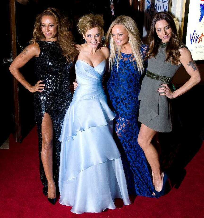 Members of the British pop girl group Spice Girls (From L-R) Melanie Brown, Geri Halliwell, Emma Bunton and Melanie Chisholm pose for pictures on the red carpet as they arrive for the premiere of the Spice Girls musical 'Viva Forever' in central London on December 11, 2012. Viva Forever is produced by Judy Craymer, written by Jennifer Saunders and features the music of the Spice Girls. AFP PHOTO/Leon NealLEON NEAL/AFP/Getty Images (Leon NealLEON NEAL/AFP/Getty Images)