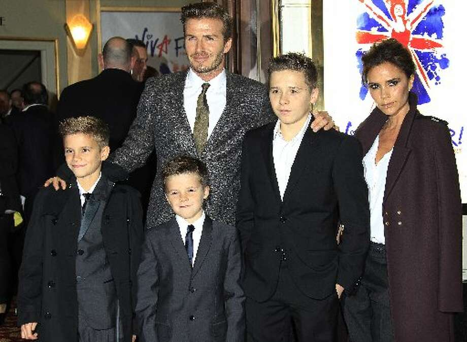 The Beckham family arrive for 'Viva Forever!' Press Night, a musical based on the songs of the Spice Girls, at the Piccadilly Theatre in central London, Tuesday, Dec. 11, 2012. (Photo by Joel Ryan/Invision/AP) (Joel Ryan/Invision/AP)