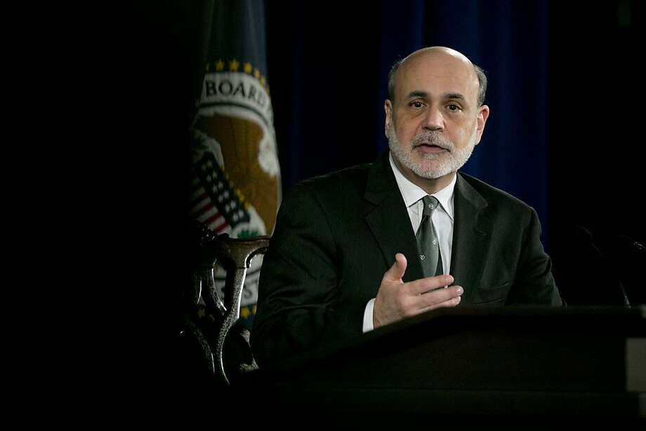 Fed Chairman Ben Bernanke says the Fed will continue to pursue its purchase of Treasurys. Photo: Andrew Harrer, Bloomberg