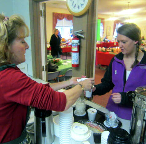 Megan Leach happily receives a steaming cup of hot chocolate from church volunteer Lynne Gomez during the Sherman Congregational Church's annual holiday fair. Dec. 1, 2012 Photo: Norm Cummings