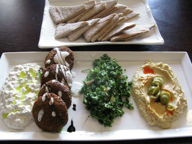 At Azro Moroccan Mediterranean Bistro, an appetizer Azro Plate for Two comes with (from left) baba ghanoush, falafel, tabbouli and hummus.