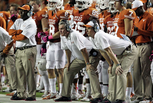 Much like old times, Mack Brown (left) will let Major Applewhite run the Texas offense. Photo: Tom Reel, San Antonio Express-News / ©2012 San Antono Express-News