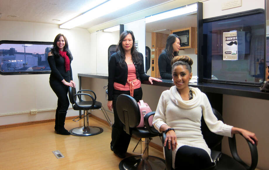 Stylists Mara, Serena, and Anais pose inside their salon. (Riva Gold/ Peninsula Press) Photo: Picasa
