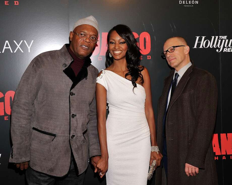 Samuel L. Jackson, Nichole Galicia, and Christoph Waltz attend a screening of Django Unchained hosted by The Weinstein Company with The Hollywood Reporter, Samsung Galaxy and The Cinema Society at Ziegfeld Theater on December 11, 2012 in New York City.  (Photo by Stephen Lovekin/Getty Images) Photo: Stephen Lovekin, Getty Images / 2012 Getty Images