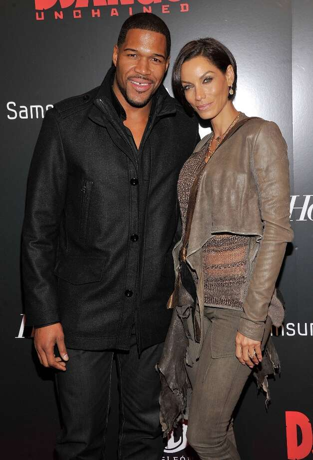 Michael Strahan and Nicole Murphy attends a screening of Django Unchained hosted by The Weinstein Company with The Hollywood Reporter, Samsung Galaxy and The Cinema Society at Ziegfeld Theater on December 11, 2012 in New York City.  (Photo by Stephen Lovekin/Getty Images) Photo: Stephen Lovekin, Getty Images / 2012 Getty Images