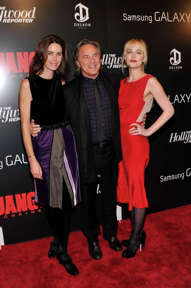 Kelley Phleger, Don Johnson and Dakota Johnson attend a screening of Django Unchained hosted by The Weinstein Company with The Hollywood Reporter, Samsung Galaxy and The Cinema Society at Ziegfeld Theater on December 11, 2012 in New York City.  (Photo by Stephen Lovekin/Getty Images) Photo: Stephen Lovekin, Getty Images / 2012 Getty Images