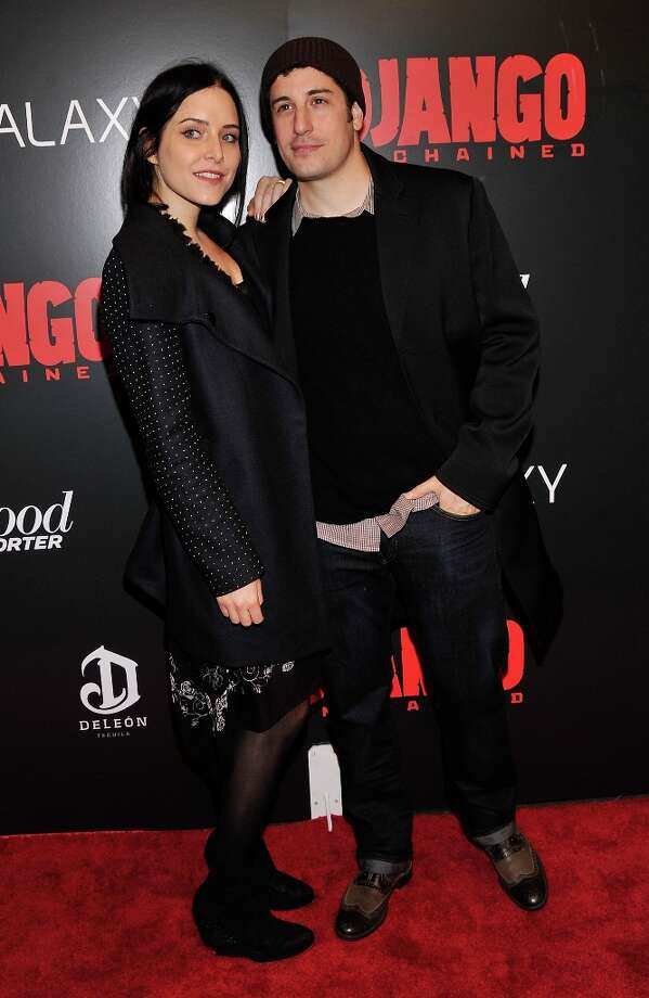 Jason Biggs and Jenny Mollen attends a screening of Django Unchained hosted by The Weinstein Company with The Hollywood Reporter, Samsung Galaxy and The Cinema Society at Ziegfeld Theater on December 11, 2012 in New York City.  (Photo by Stephen Lovekin/Getty Images) Photo: Stephen Lovekin, Getty Images / 2012 Getty Images