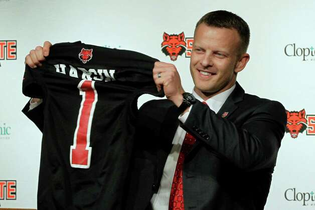 Former Texas offensive play-caller Bryan Harsin is introduced as Arkansas State's new coach during a news conference Wednesday. Photo: Danny Johnston, Associated Press / AP