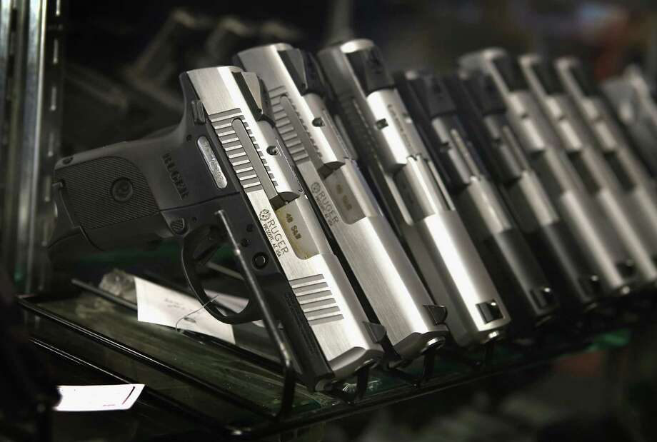 The 7th Circuit Court of Appeals reversed a lower court ruling in two cases that upheld the state's longstanding prohibition against carrying concealed weapons. Illinois is the only state with an outright prohibition on concealed carry. Photo: Scott Olson, Getty Images / 2012 Getty Images