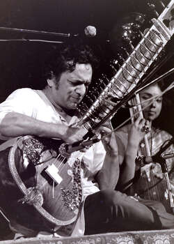 This August 1969 photo provided by Mark Goff shows Ravi Shankar performing at the Woodstock music festival in Woodstock, N.Y.  Shankar, who is credited with connecting the world to Indian music, died Tuesday, Dec. 11, 2012 in San Diego at the age of 92. Photo: Mark Goff, Associated Press / Mark Goff
