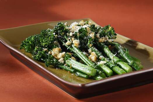 "Broccoli rabe (BROK-ah lee rob): From the turnip family, broccoli rabe is a leafy green with small broccoli-like florets. Both are edible. Audio: Click here to hear the term ""Broccoli rabe."" Photo: Craig Lee, Special To The Chronicle"