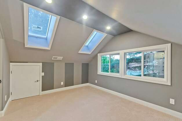 Gabled ceilings featuring skylights are found in both homes. Photo: Victor Lin/Victor Lin Photograph