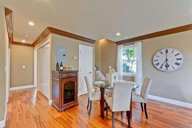 The dining room features the same crown molding that is found throughout the rest of the home. Photo: Victor Lin/Victor Lin Photograph