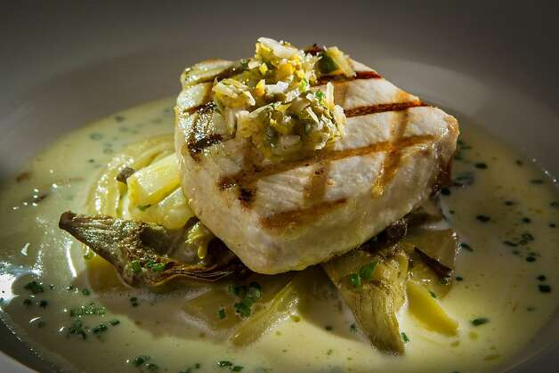 The swordfish is arranged on a bed of artichokes with preserved Meyer lemon, making for a well-balanced dish where all the components work together. Photo: John Storey, Special To The Chronicle