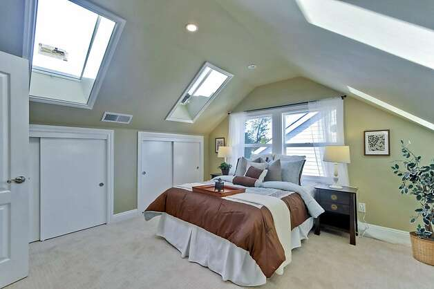 The master bedroom features a gabled roof with skylights. Photo: Victor Lin/Victor Lin Photograph