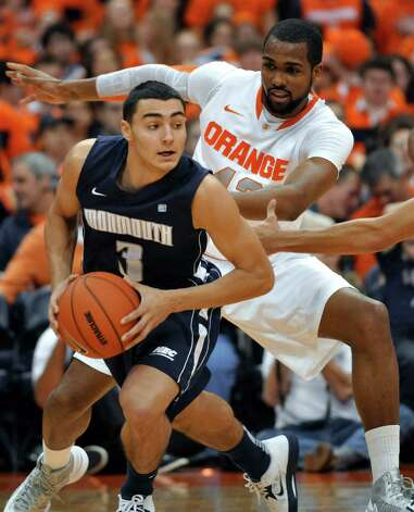 Syracuse's James Southerland defends against Monmouth's Max DiLeo during the first half of an NCAA college basketball game in Syracuse, N.Y., Saturday, Dec. 8, 2012. (AP Photo/Kevin Rivoli) Photo: Kevin Rivoli, Associated Press / FR60349 AP